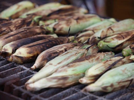 Boy Scout tropp 36, of New Albany roasted corn to sell at the Harvest Homecoming Festival. Oct. 8, 2015.