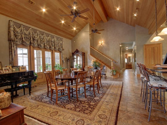 A large dining area and open bar are perfect for entertaining.