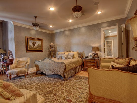 Inviting master suite includes both his and hers baths.
