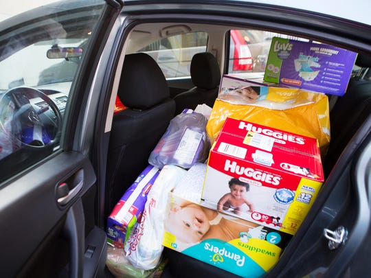 Diaper and wipe donations from the Democrat and Chronicle diaper drive for ROC City Bottoms fill a car on Wednesday.
