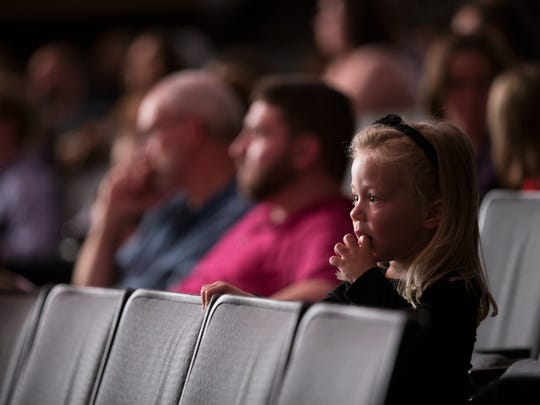 Brielle Ladow, 3, of Victor listens as the RPO plays a song during the OrKIDStra Concert in Hochstein Performance Hall on Sunday, October 11, 2015.