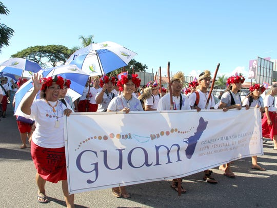 In this 2012 photo, members of the delegation from Guam march during a parade at the 11th Festival of Pacific Arts in Honiara, Solomon Islands.