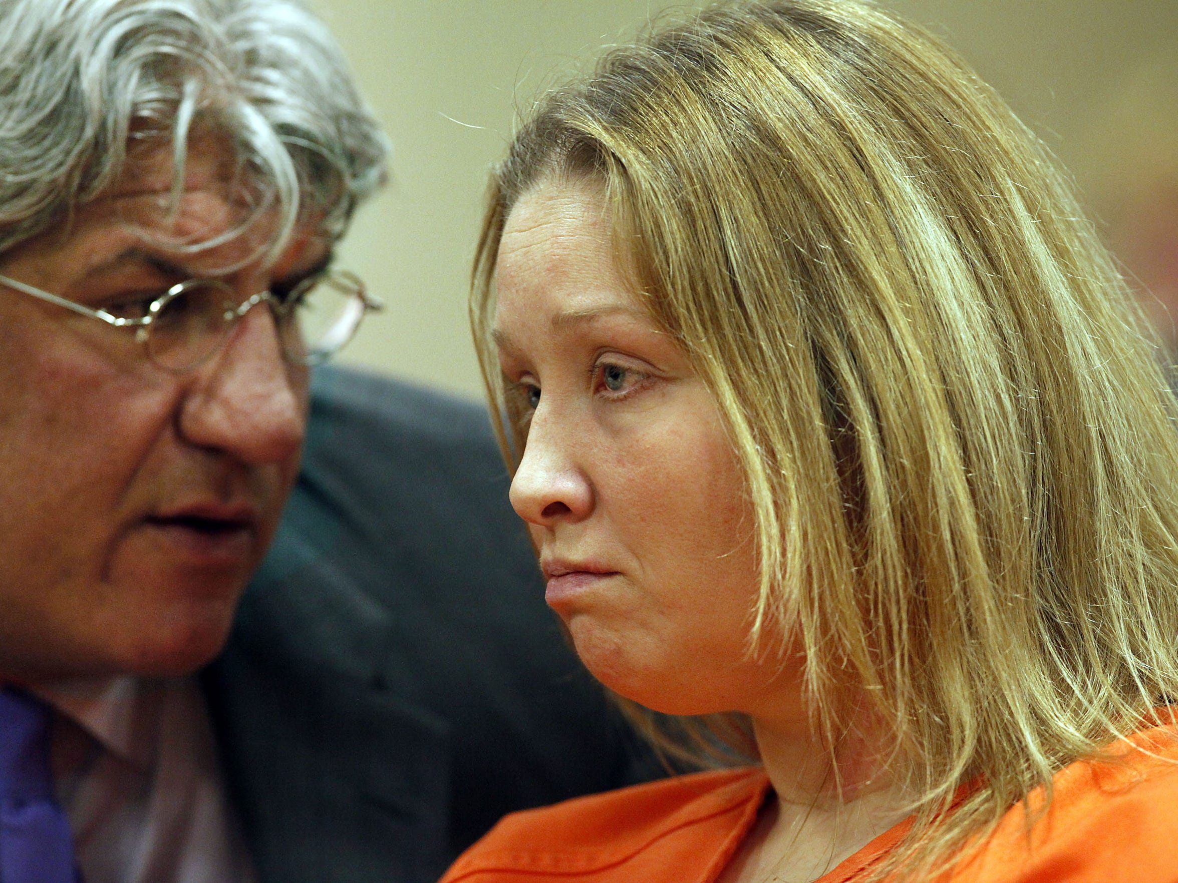 Kandi Siveny listens to her attorney, Michael Hart, during witness testimony at the Outagamie County Justice Center in 2013.