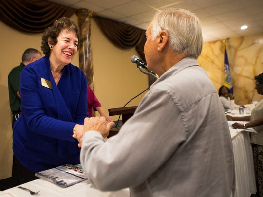 Monroe County Executive candidate Sandra Frankel is greeted by Brighton resident Hollis Hames at a luncheon for UAW retirees at the Diplomat Banquet Center on Oct. 15.