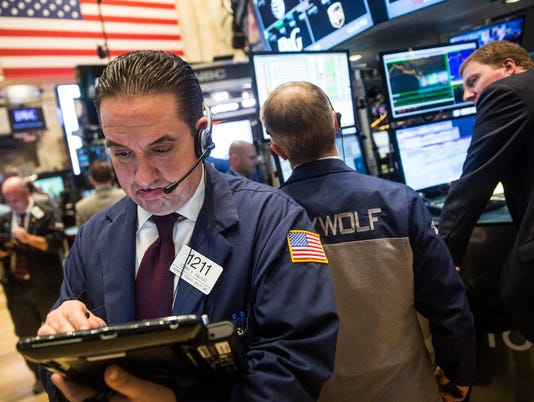 Dow jumps 217 points, Nasdaq up 1.8% on hike delay hope