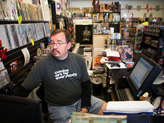 Craig DeMeyers, owner of Two Kings Comics in Victor puts in an order for new merchandise on Oct. 16, 2015.