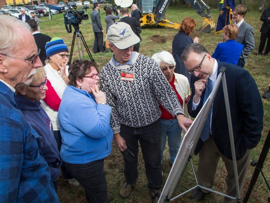 People inspect the blueprints of the Year Round Regional
