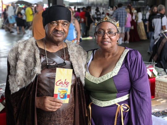 Freddy B. Gibson, left, and Rosa Fritts, right, attend the Michigan Renaissance Festival Kick-Off Party at Eastern Market on Sunday, August 9, 2015.