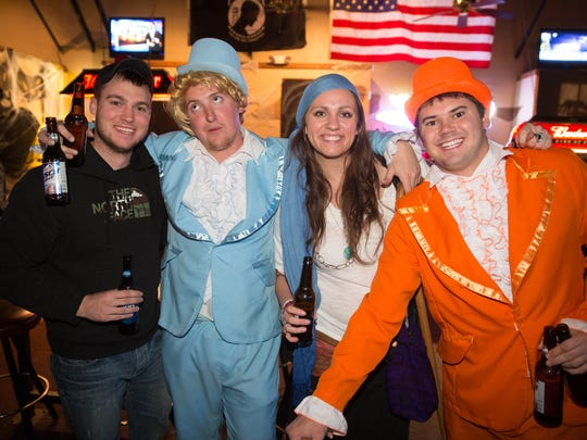 Mike Shultz, Steve Miller, Tara Lappin, Johnston and Taylor Young dressed up for the 2014 Halloween costume contest at Miss Kitty's in Clive.