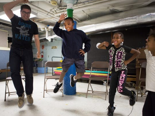 Aaron Frasier, 8, jumps in the air as he leads the rest of the ROCMusic class in a dance at Edgerton Recreation Center on Thursday.