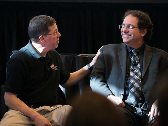 Bill Stackpole, associate professor of computing security at RIT, and Kevin Mitnick, American computer security consultant and hacker, speak to employees at Systems Management Planning in Henrietta on Friday, October 23, 2015.