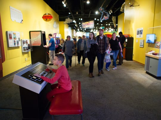 Austin Bennett, 9, of Syracuse plays giant Super Mario at the Nintendo exhibit opening at the Strong Museum of Play on Saturday, October 24, 2015.