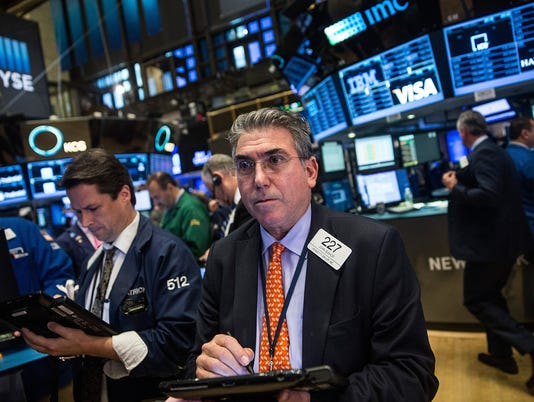 Back in black! Dow turns positive for 2015