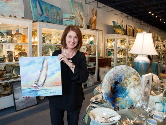Hillyer House owner Paige Riley displays Jean McKee's