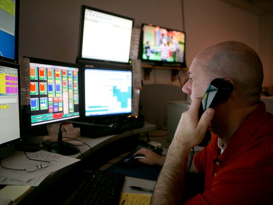 Dispatcher Brian Turner takes a call at the combined dispatch center in the Wood County Courthouse in Wisconsin Rapids on Nov. 5, 2015.