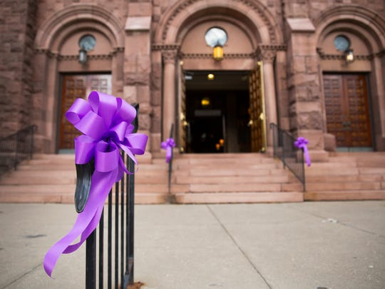 Bows lead up to St. Mary's Church in Canandaigua where Courtney Wagner's funeral was held on Saturday, November 7, 2015.