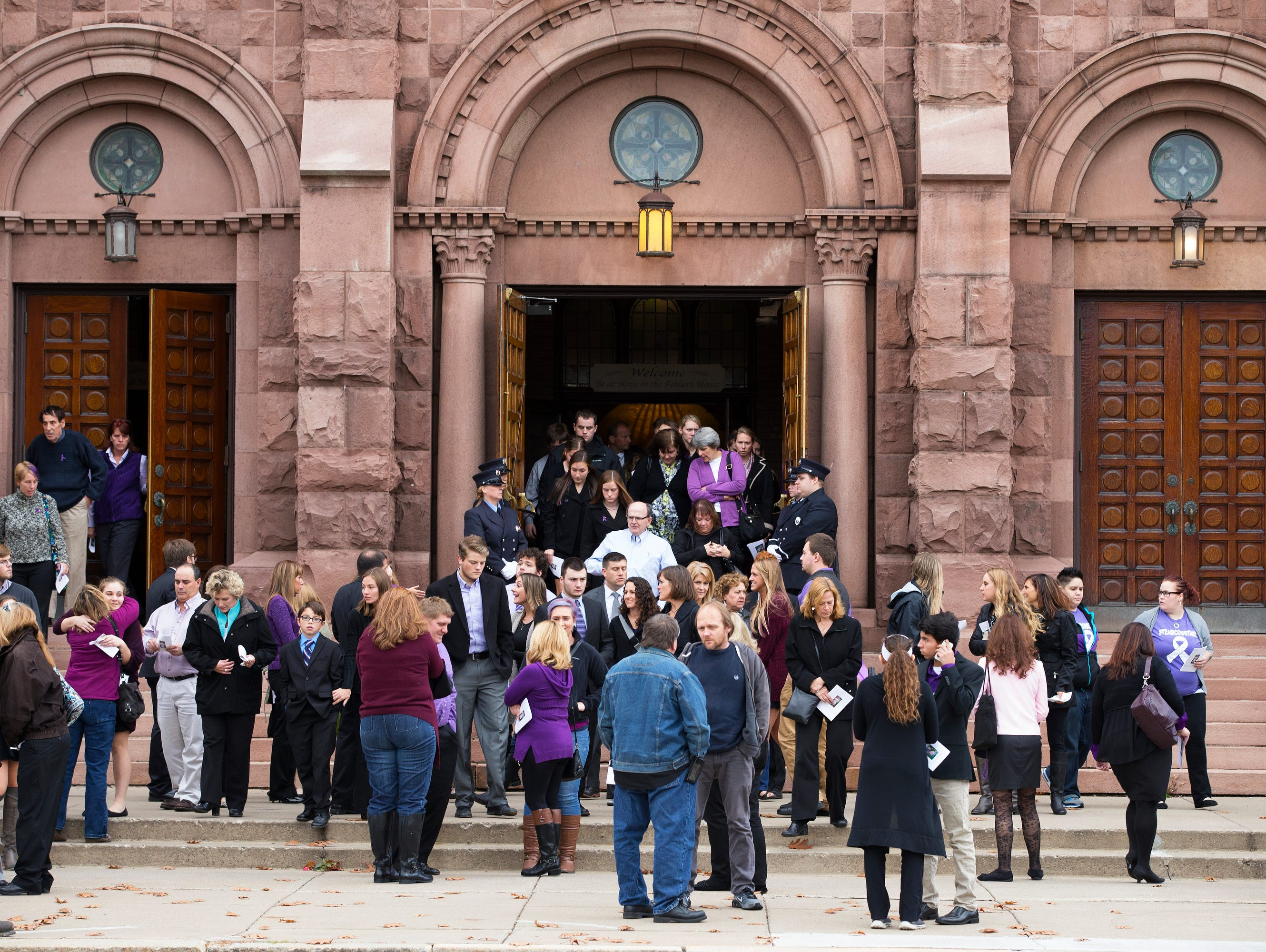 People pour out of St. Mary's Church following Courtney Wagner's funeral in Canandaigua on Saturday, November 7, 2015.