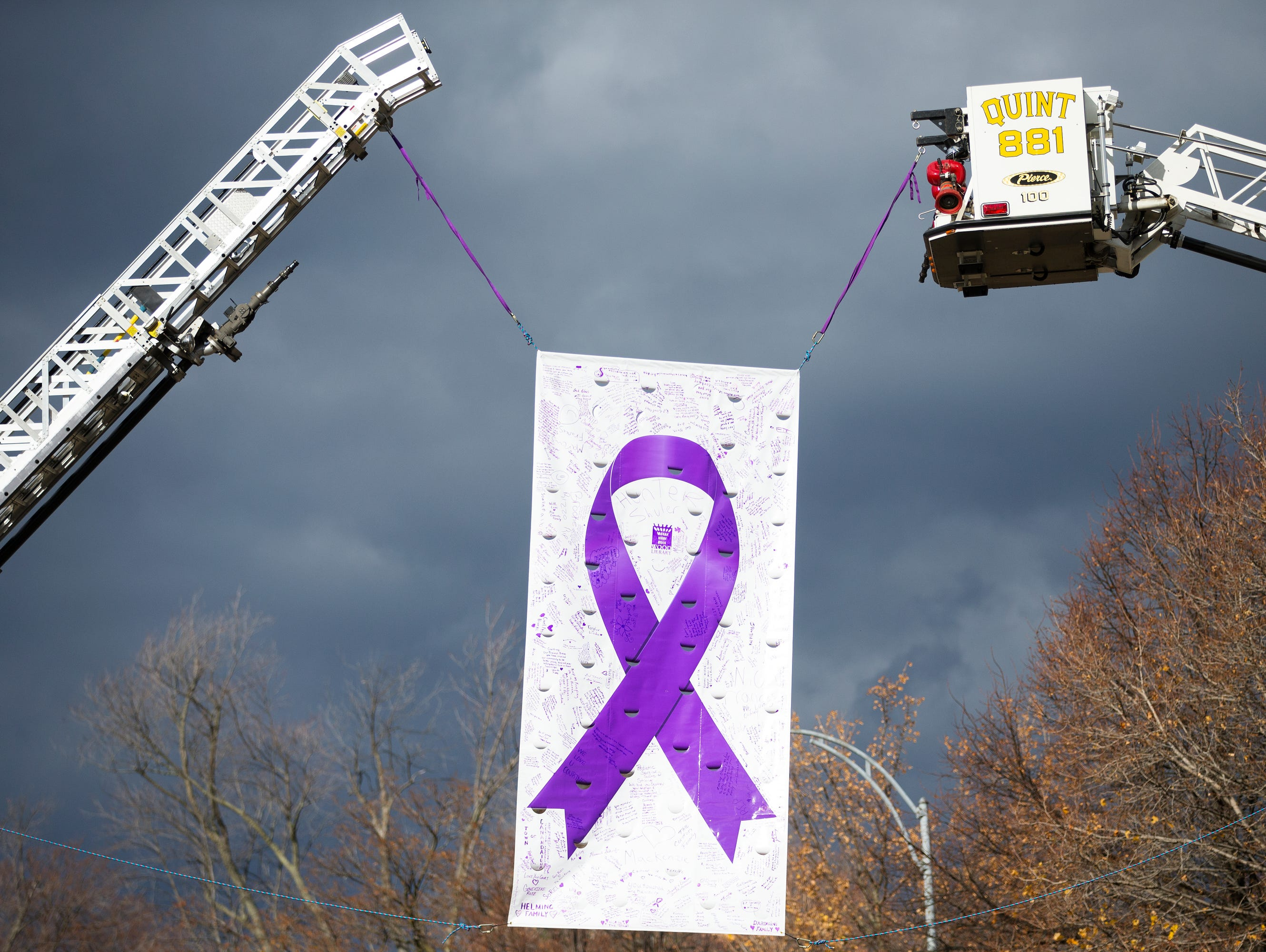 A banner with signatures and notes for Courtney Wagner hangs over N Main St. in Canandaigua during her funeral on Saturday, November 7, 2015.