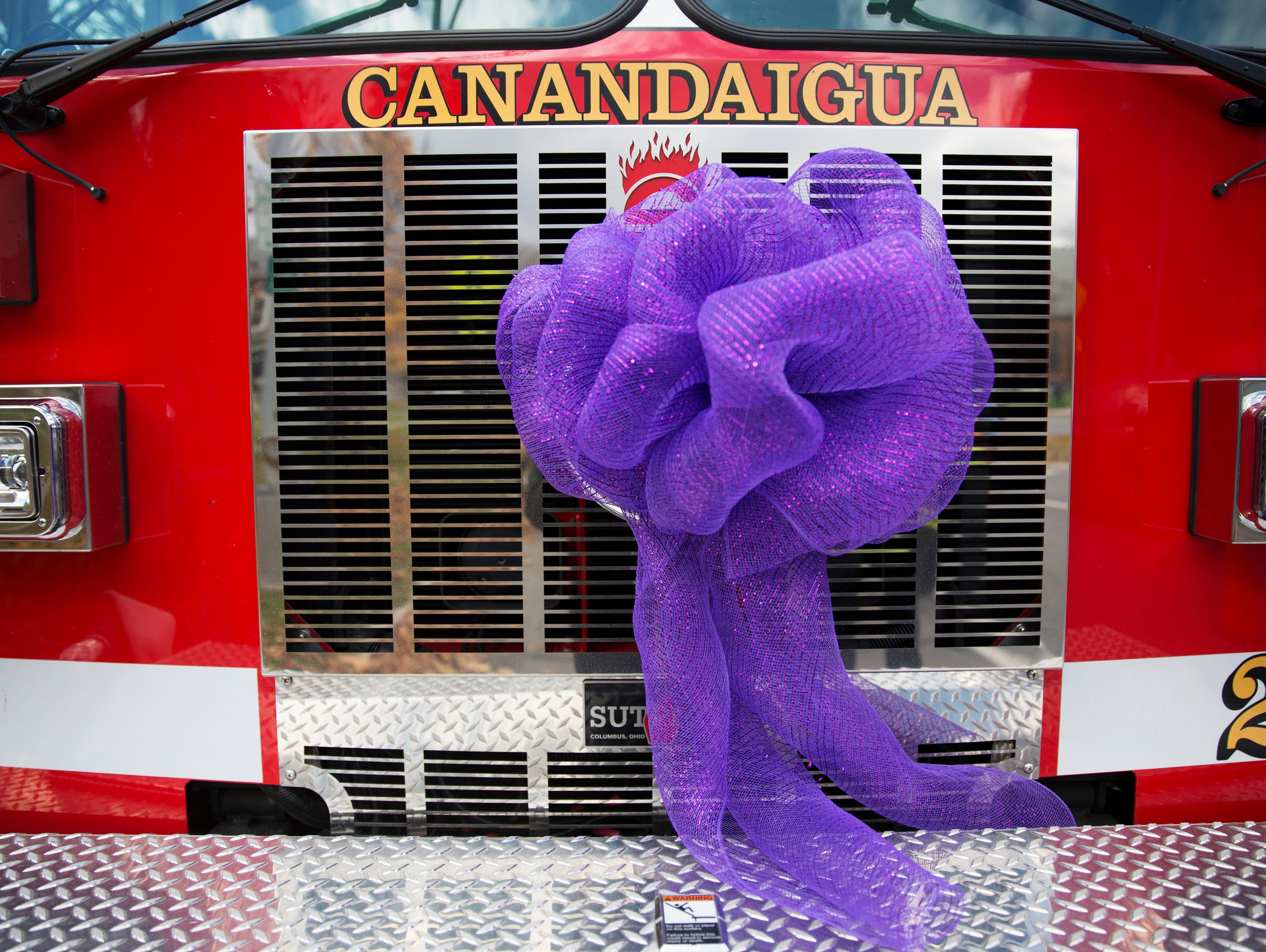 A Canandaigua fire truck is adorned with a purple bow outside of Courtney Wagner's funeral at St. Mary's Church in Canandaigua on Saturday, November 7, 2015.