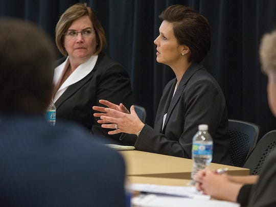 Amy McCoy, center, a spokeswoman for the Iowa Department of Human Services, said in November 2015 the state sees the clinics planned by Medicaid managers as boosting health service options in the state.