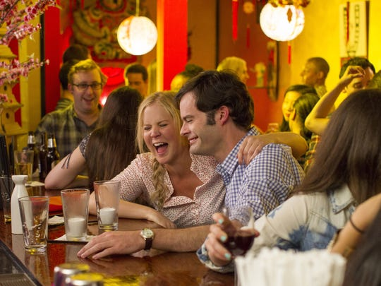"This photo provided by Universal Pictures shows, Amy Schumer , left, as Amy, and Bill Hader as Aaron, on a date in ""Trainwreck,"" the new comedy from director/producer Judd Apatow. The movie releases in the U.S. on July 17, 2015.  (Mary Cybulski/Universal Pictures via AP)"