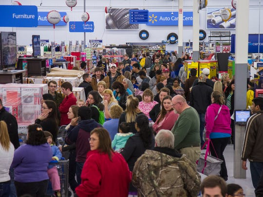 Customers shop during Walmart's Black Friday event