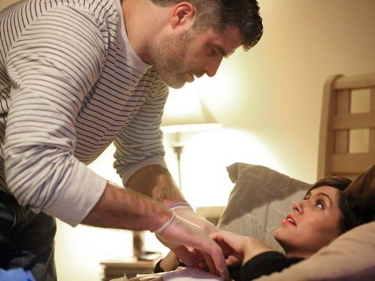Bart Conley helps his wife Jill Conley, a cancer patient,