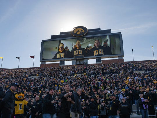 Iowa wrestlers on the video screen during the Grapple on the Gridiron Iowa vs. Oklahoma State wrestling dual meet at Kinnick Stadium in Iowa City, Saturday, Nov. 14, 2015.