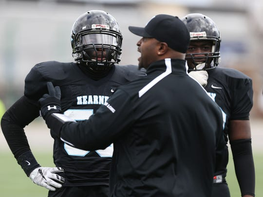 Bishop Kearney Head Coach Eddie Long talks to players