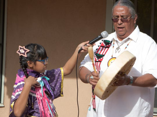 Marty Silva of the Tigua Pueblo from El Paso sings a Native American song while Star Nez holds the mic Saturday during the third annual Native American Market at Mesilla Valley Bosque State Park.