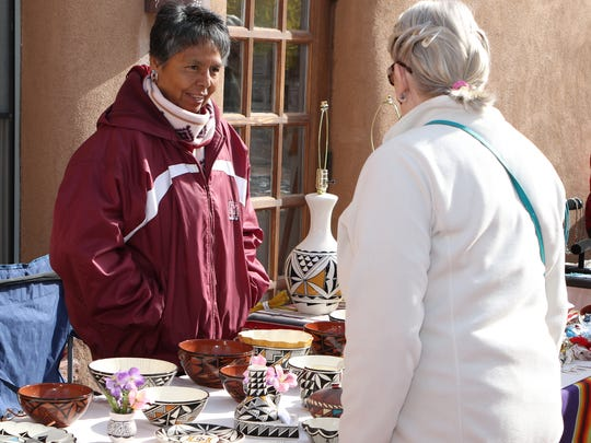 Diana Chino of the Pueblo of Acoma, shows her ceramics Saturday during the third annual Native American Market at Mesilla Valley Bosque State Park.