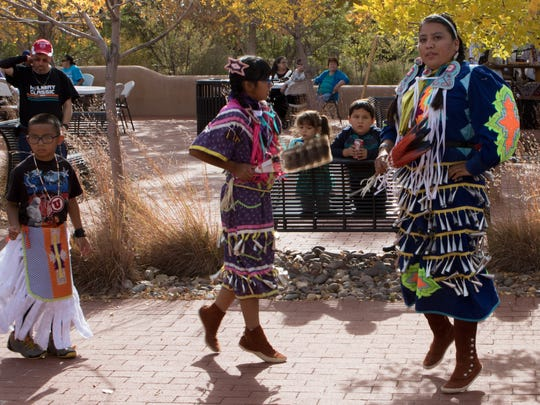 Quanah Nez, from left, Carley Nez and Carmen Claw, perform Saturday during the third annual Native American Market at Mesilla Valley Bosque State Park.