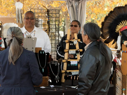 Marty and Bernadette Silvas, of the Tigua Pueblo of El Paso, show their art, jewelry and beadwork Saturday during the third annual Native American Market at Mesilla Valley Bosque State Park.
