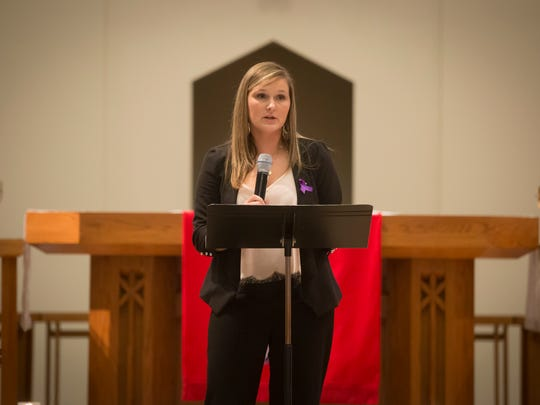 Domestic abuse survivor and keynote speaker Tiffany Allison of Des Moines speaks at a vigil honoring victims of domestic violence hosted by the Domestic/Sexual Assault Outreach Center at St. Paul Lutheran Church in Fort Dodge, Iowa Thursday, Oct. 22, 2015.