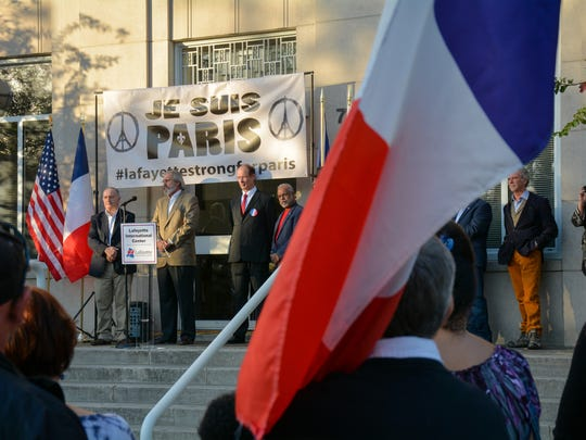 Christian M. Goudeau, honorary consul of France for Acadiana, speaks during a rally showing solidarity and support with the people of Paris in downtown Lafayette Sunday.