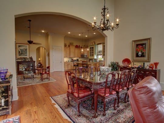 The kitchen opens to a formal dining area.