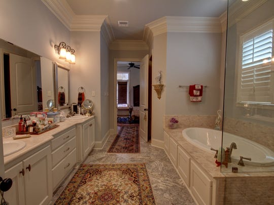 A gorgeous master bath offers a huge closet for storage.