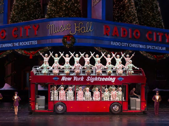 """A scene from the """"Radio City Christmas Spectacular"""" finds The Rockettes on a sightseeing tour of Manhattan."""