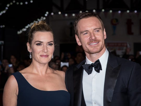 Kate Winslet and Michael Fassbender pose for photographers