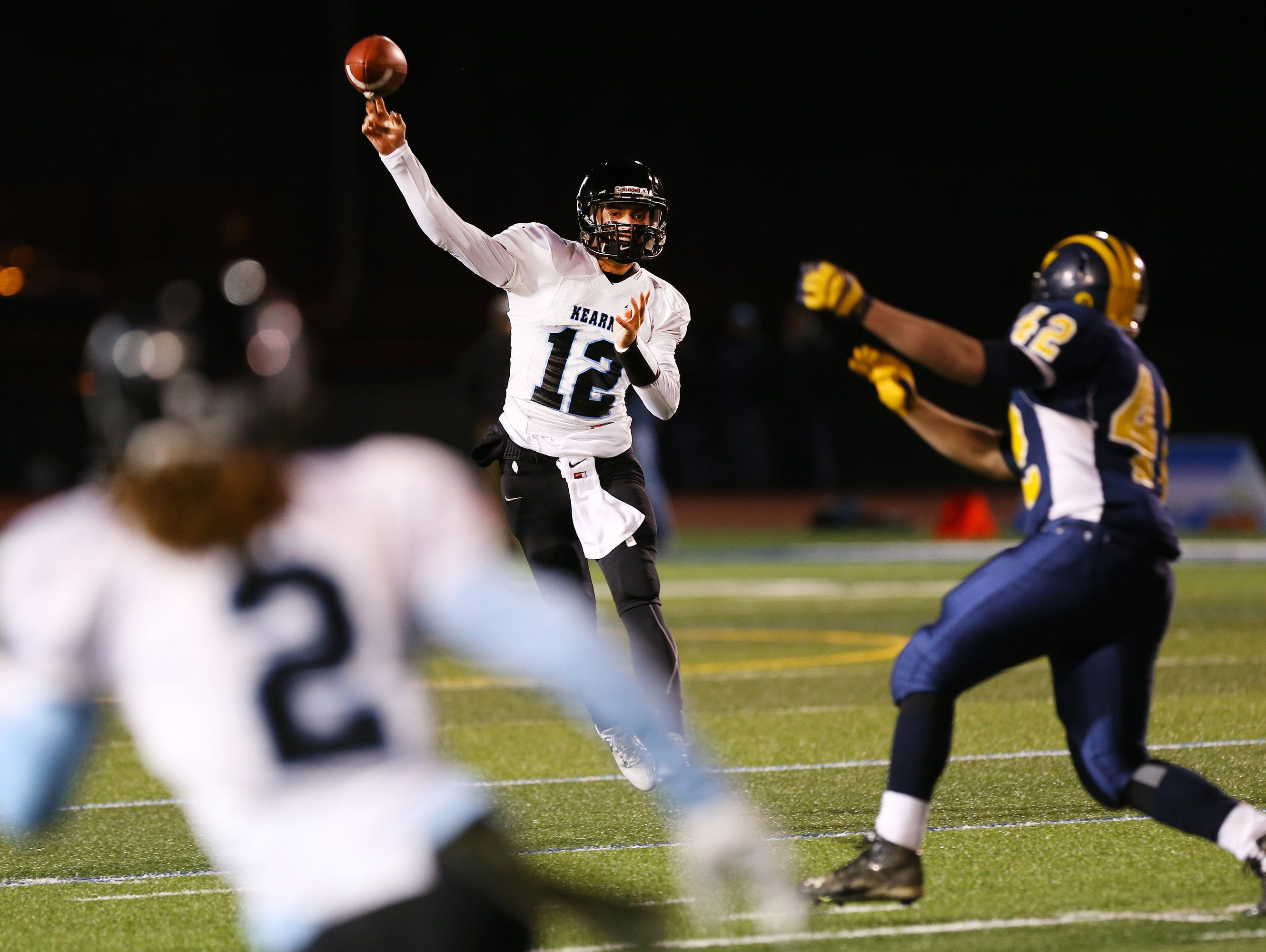 Bishop Kearney's Todd LaRocca passes to Justin Davis during the Class D state semifinal game at Cicero-North Syracuse High School on Friday, November 20, 2015.