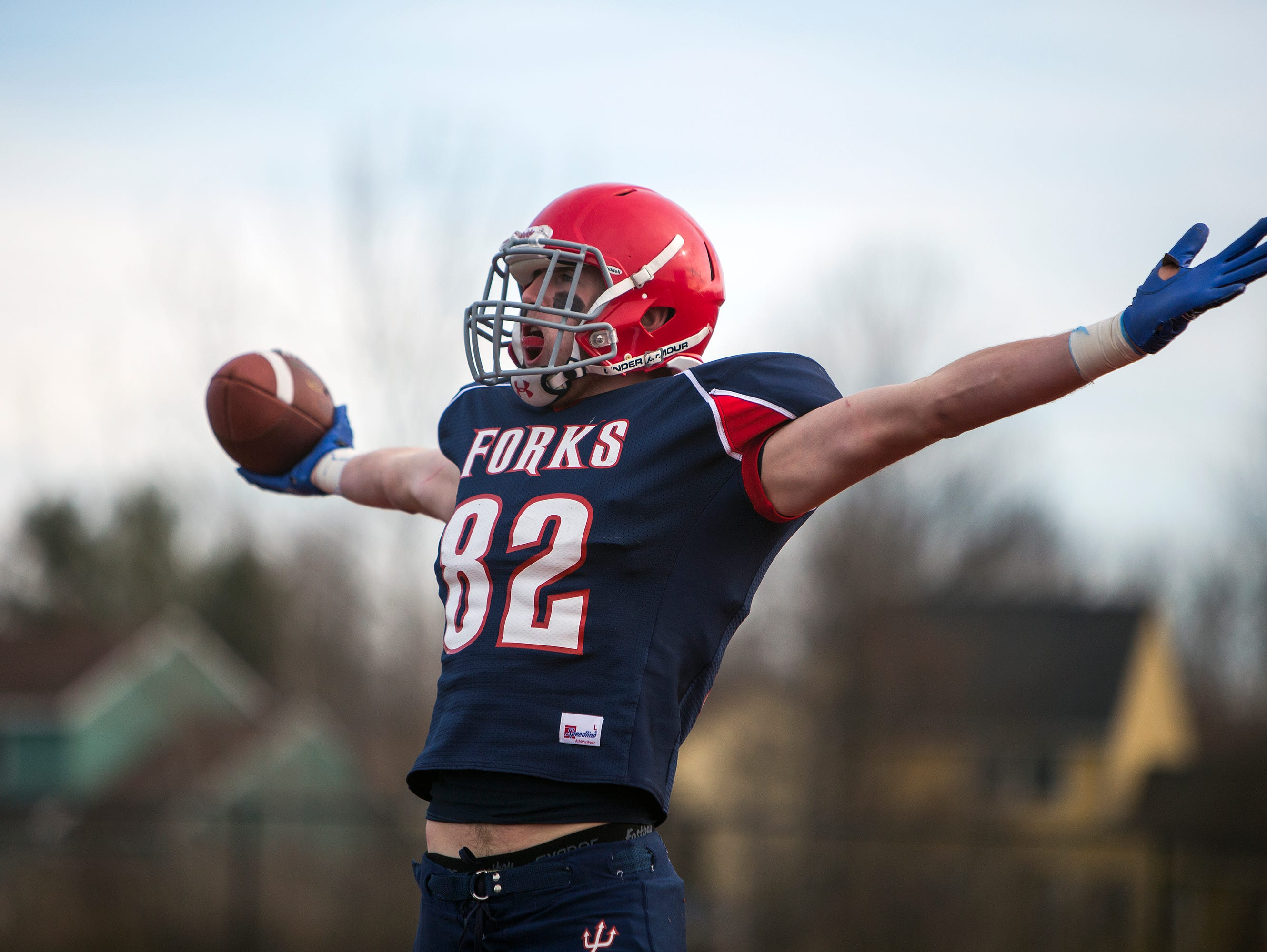 Chenango Forks tight end Trevor Borchardt celebrates his touchdown reception during the first quarter of the Class C state playoff semifinal against Bath on Saturday, Nov. 21, 2015.