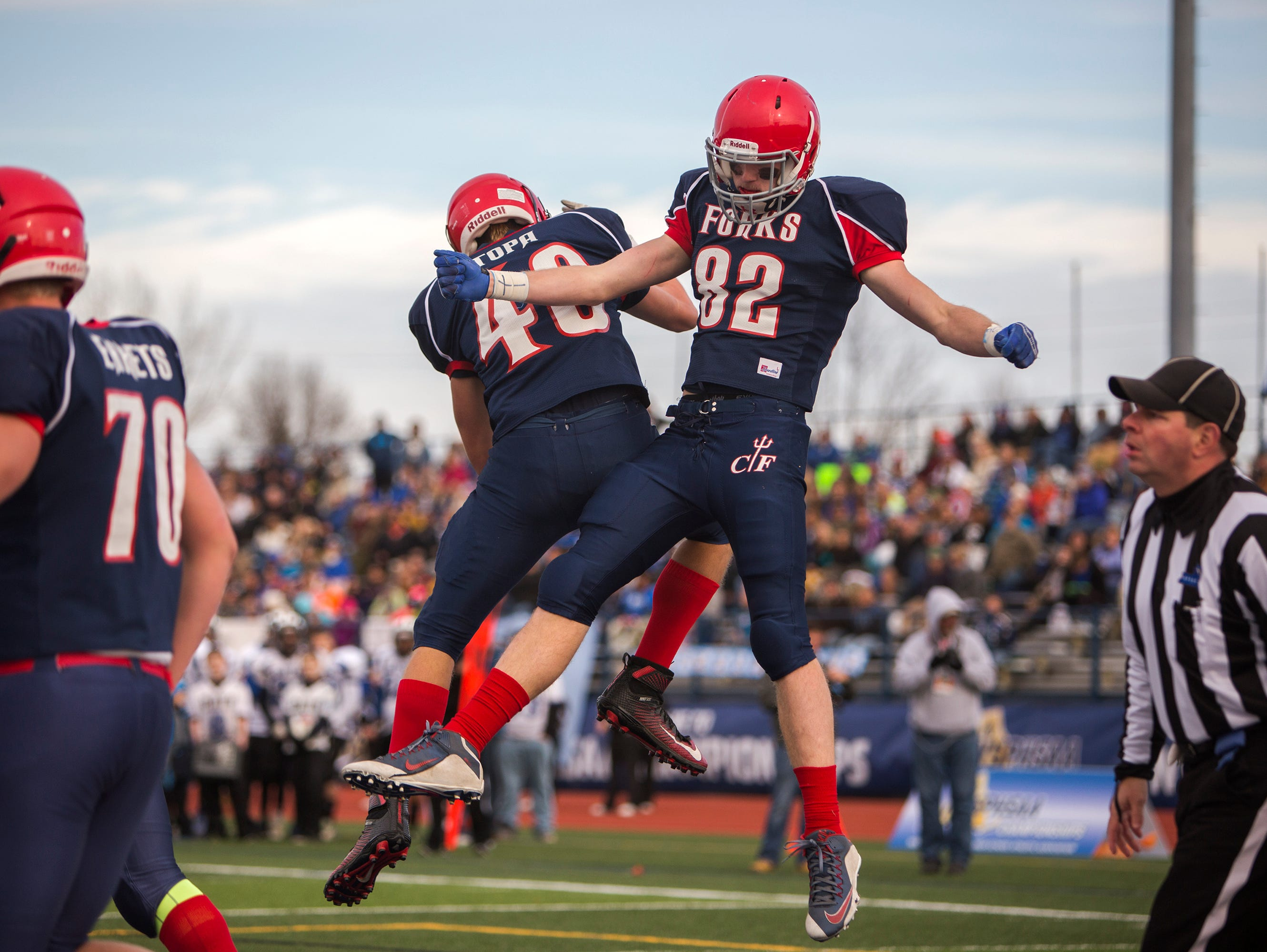 Chenango Forks tight end Trevor Borchardt, right, celebrates his first quarter touchdown reception with teammate Collin Topa in the Class C state playoff semifinal against Bath on Saturday, Nov. 21, 2015.
