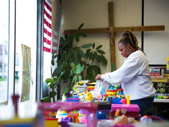 Sylvia Chambers, supervisor of New Life Toys, organizes