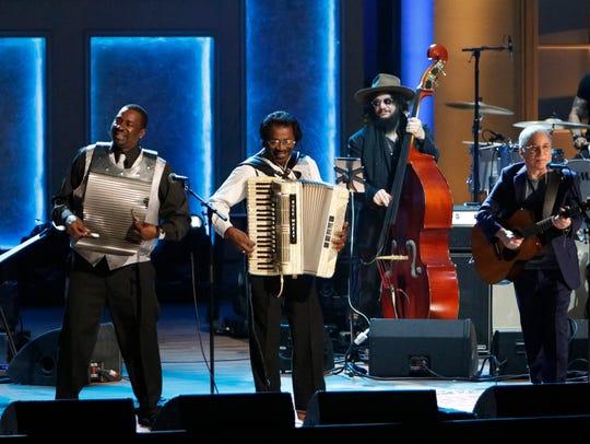 "Buckwheat Zydeco and Paul Simon perform ""Man With the"