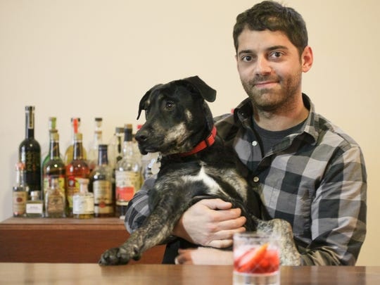 Doug Petry, beverage director at Rye on Market, with his dog Lester, at his home in Louisville.