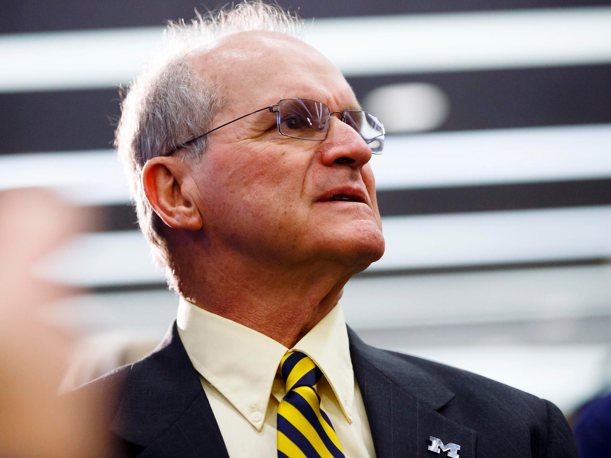 Crestline native Jack Harbaugh as his son, Jim, is introduced as Michigan's new head football coach last December.