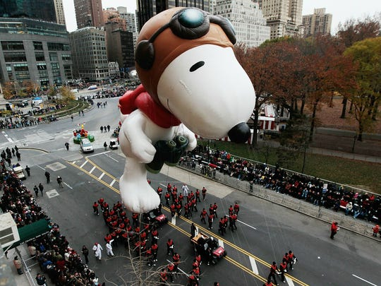 The Snoopy float glides down Central Park South during