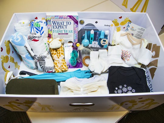 "This is a ""Baby Box"" handed out to expectant mothers for free by the Mountain Park Health Center in Phoenix. The box contains items to help a new mother take care of her newborn, including a thermometer, booties, blankets, and an umbrella for a stroller, among other items."