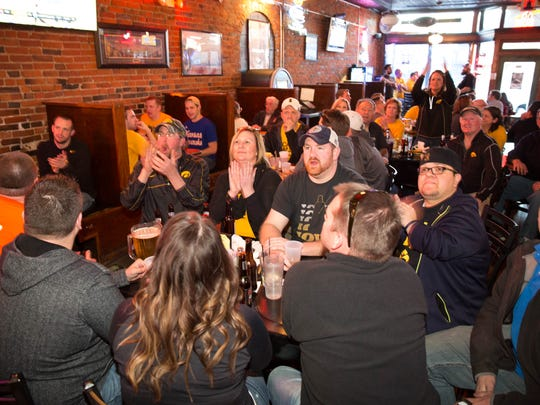 Fans watch Iowa take on Davidson Friday, March 20, 2015, at The Longest Yard in West Des Moines.