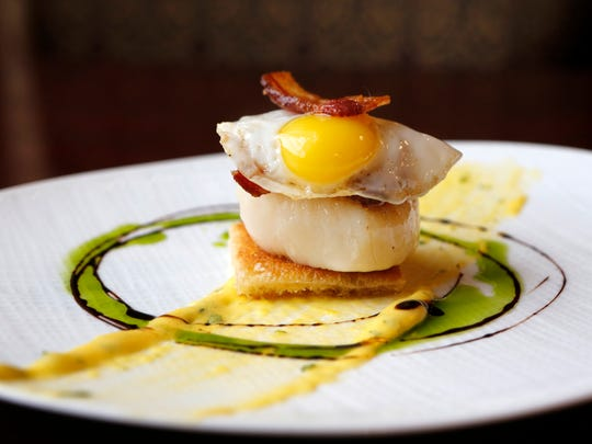 The seared scallop Benedict at the English Grill.